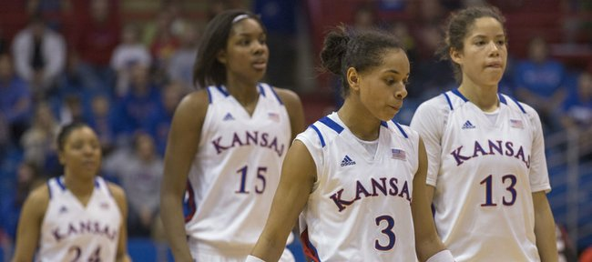 Kansas players CeCe Harper (24), Chelsea Gardner (15), Angel Goodrich (3) and Monica Engelman (13) walk off the court during a time out late in the second half of Kansas' women's game against Texas Tech, Sunday at Allen Fieldhouse.