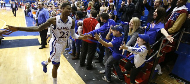 Kansas fans reach to slap hands with Ben McLemore as he exits the floor after a 33-point performance and a game-tying three that send the game into overtime on Wednesday, Jan. 9, 2013 at Allen Fieldhouse.