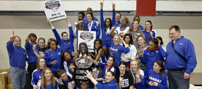 Kansas University's women's track and field team celebrates its Big 12 Indoor title on Sunday, Feb. 24, 2013, in Ames, Iowa.