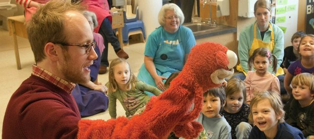 Puppeteer Spencer Lott, 25, of Kansas City, Mo., spent some time on Feb. 7 entertaining preschoolers at the Lawrence Arts Center, 940 New Hampshire St., with some of his handmade puppets. Lott, who graduated from Free State High School, has been interested in puppeteering since kindergarten.