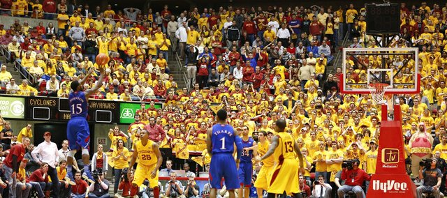Kansas guard Elijah Johnson puts up a deep three with 56 seconds remaining in overtime against Iowa State on Monday, Feb. 25, 2013 at Hilton Coliseum in Ames, Iowa.