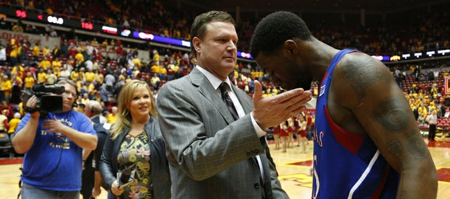 Kansas head coach Bill Self gives a congratulatory pat to Elijah Johnson after the Jayhawks' 108-96 overtime win over Iowa State on Monday, Feb. 25, 2013 at Hilton Coliseum in Ames, Iowa.