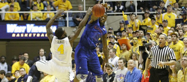 Kansas guard Elijah Johnson goes for a steal against West Virginia&#39;s Jabarie Hinds (4) in the Jayhawks&#39; game against the Mountaineers on Monday night in Morgantown, W.Va.