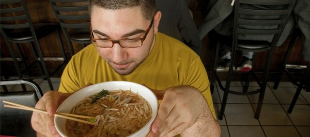 Randy David, 24, Lawrence enjoys a bowl of pho at Little Saigon Café, 1524 W. 23rd St., where traditional bowls of noodles and plates of rice with veggies can make a healthy meal for anyone.