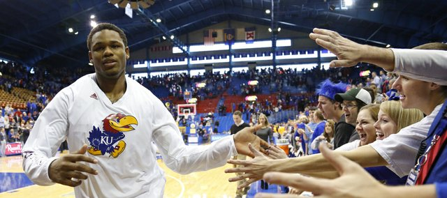 Kansas guard Ben McLemore slaps hands with KU fans following his 36-point effort, the most by a freshman since Danny Manning, following the Jayhawks&#39; 91-65 win over West Virginia on Saturday, March 2, 2013 at Allen Fieldhouse.