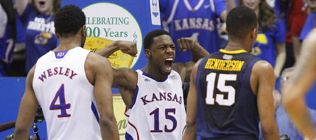 Kansas guard Elijah Johnson flexes following a posterizing dunk against a West Virginia player during the second half on Saturday, March 2, 2013 at Allen Fieldhouse.