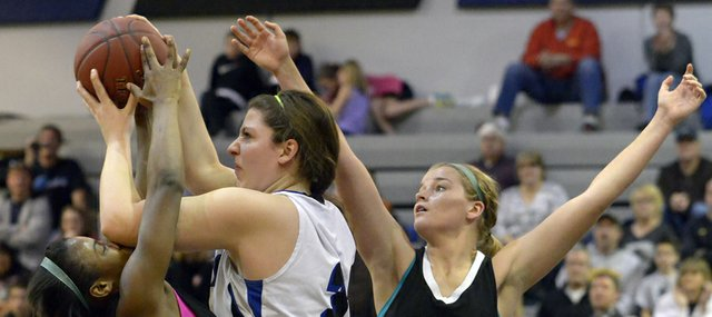 Firebirds A'Liyah Rogers, left, and Chelsea Casady (32) double-team Michaela Crall in Free State's 68-31 loss to Olathe Northwest on Saturday, March 2, 2013, in Olathe.