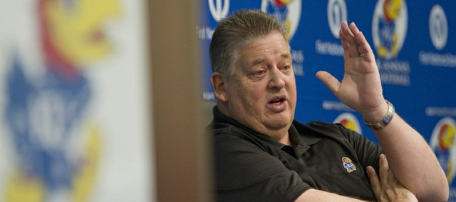 KU football coach Charlie Weis speaks to reporter about the depth chart during a spring football practice news conference Monday, March, 4, 2013, at KU. KU will begin spring drills today and will practice five times before taking a week off for spring break. The annual spring game, is slated for a 1 p.m. kickoff on April 13 at Memorial Stadium..
