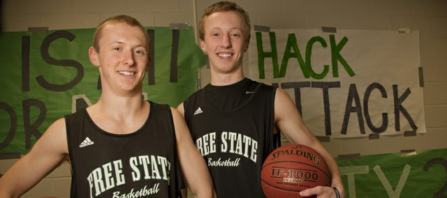 Free State senior Wilson hack, left, and brother Weston, a sophomore, get one last chance to play high school basketball together at this week's Class 6A state tournament. The Firebirds take on Blue Valley Northwest at 3 p.m. today in Wichita.