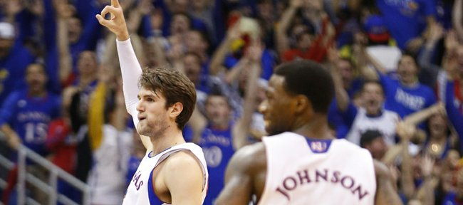 "Kansas center Jeff Withey signals ""three"" after hitting one against Texas Tech during the first half, Monday, March 4, 2013 at Allen Fieldhouse."