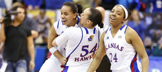 Kansas senior point guard Angel Goodrich is hoisted up by teammate Markisha Hawkins (54) following their 74-67 win, Tuesday, March 5, 2013 at Allen Fieldhouse. At right is Kansas guard CeCe Harper.