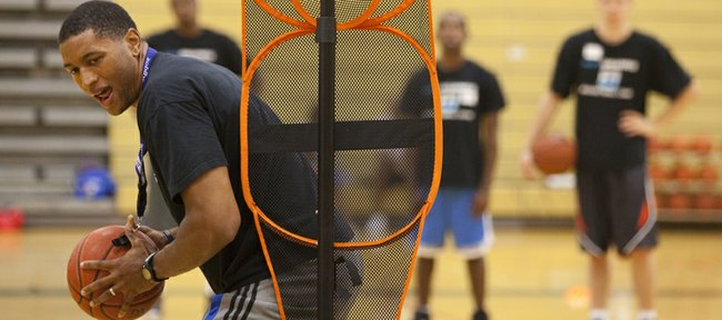 Former Kansas University forward Wayne Simien makes his way through a basketball drill at his Called to Greatness camp in this photo from 2011.