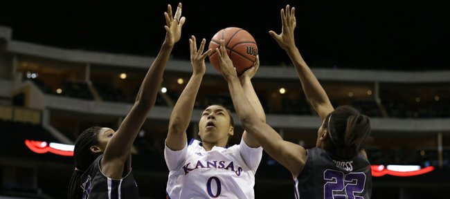 TCU' Latricia Lovings, left, and Delisa Gross (22) defend against a shot attempt by Kansas 's Asia Boyd (0) in the second half of an NCAA college basketball game in the Big 12 women's tournament Friday, March 8, 2013, in Dallas. Kansas won 83-61.