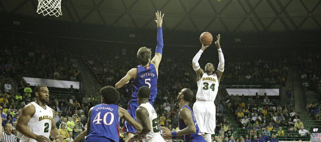 Baylors Cory Jefferson (34) fires in a shot over Jeff Withey (5) in KU's 81-58 loss to the Baylor Bears Saturday in Waco.