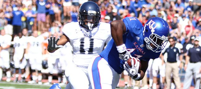 Kansas tight end Jimmay Mundine heads into the endzone for a touchdown past Rice corner back Malcolm Hill during the first quarter on Saturday, Sept. 8, 2012 at Memorial Stadium.