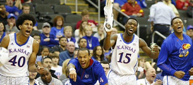 Kansas players Kevin Young, left, Travis Releford, Elijah Johnson and Ben McLemore react to a bucket and a foul by teammate Jamari Traylor against Texas Tech during the second half of the second round of the Big 12 tournament on Thursday, March 14, 2013 at the Sprint Center in Kansas City, Missouri.