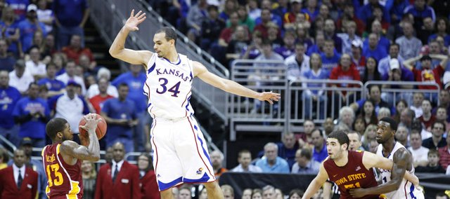 Kansas forward Perry Ellis elevates to prevent a shot by Iowa State guard Korie Lucious during the second half of the semifinal round of the Big 12 tournament on Friday, March 15, 2013 at the Sprint Center in Kansas City, Missouri.
