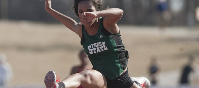Free State sophomore Gabrielle Dabney clears a hurdle on her way to a victory in the 100-meter hurdles at the Firebirds' season-opening track and field quadrangular, Thursday, March 14, 2013, at FSHS.