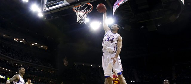 Kansas forward Perry Ellis comes in for a dunk against Iowa State during the first half of the semifinal round of the Big 12 tournament on Friday, March 15, 2013 at the Sprint Center in Kansas City, Missouri.