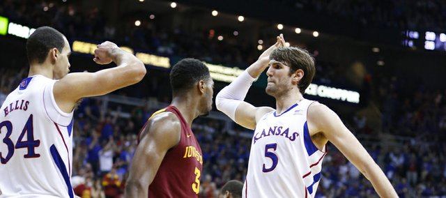 Kansas center Jeff Withey looks to high five forward Perry Ellis after Ellis hit a bucket after an Iowa State foul during the second half of the semifinal round of the Big 12 tournament on Friday, March 15, 2013 at the Sprint Center in Kansas City, Missouri.