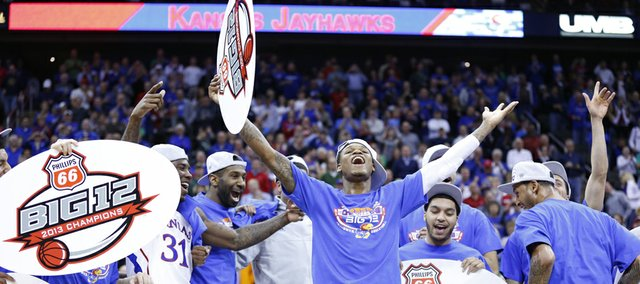 Kansas guard Ben McLemore dances on stage to the Jayhawk fans following the Jayhawks' 70-54 win over Kansas State in the Big 12 tournament championship on Saturday, March 16 2013 at the Sprint Center in Kansas City, Mo.