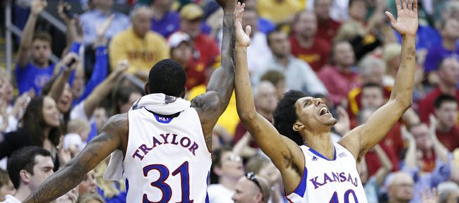 Kansas players Kevin Young (40) and Jamari Traylor celebrate a three by teammate Elijah Johnson during the second half of the semifinal round of the Big 12 tournament on Friday, March 15, 2013 at the Sprint Center in Kansas City, Missouri.