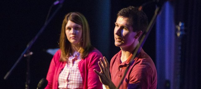 Velocity Church Pastor Justin Jenkins, right, and his wife, Marissa, discuss relationships during a Velocity Church service Sunday, March 10, 2013, at the Lawrence Arts Center, 940 New Hampshire St.