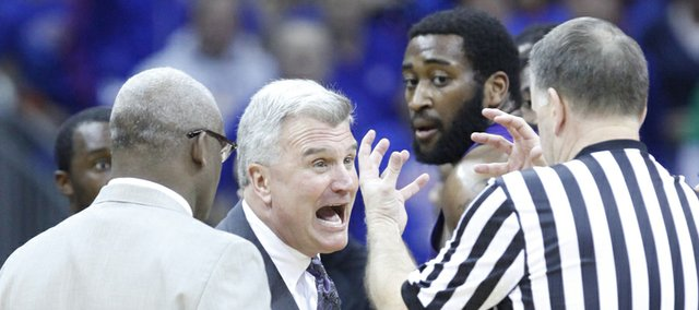 Kansas State head coach Bruce Weber gets animated with an official during the second half of the Big 12 tournament championship on Saturday, March 16 2013 at the Sprint Center in Kansas City, Mo.