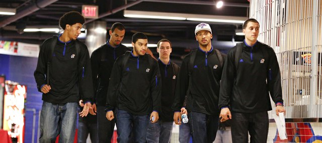 Kansas players make their way out of a NCAA selection show watch party at the fieldhouse on Sunday, March 17, 2013 at Allen Fieldhouse. From left are Kevin Young, Perry Ellis, Niko Roberts, Evan Manning, Travis Releford and Christian Garrett. Kansas was selected as the number 1 seed in the South Regional and will play Western Kentucky in the field of 64 on Friday in Kansas City.
