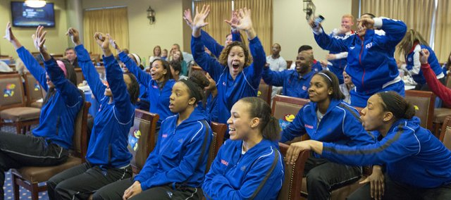 Members of the Kansas women's basketball team celebrate as they learn their fate in the 2013 NCAA Women's Tournament Monday evening at Allen Fieldhouse. The Jayhawks earned the 12th seed in the Norfolk region and will play fifth seeded Colorado at 5:30 p.m. on Saturday.