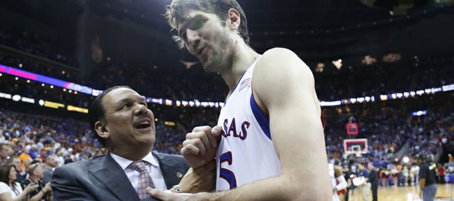 Kansas assistant coach Kurtis Townsend congratulates center Jeff Withey after the Jayhawks' 88-73 win over Iowa State on Friday, March 15, 2013 at the Sprint Center in Kansas City, Missouri.