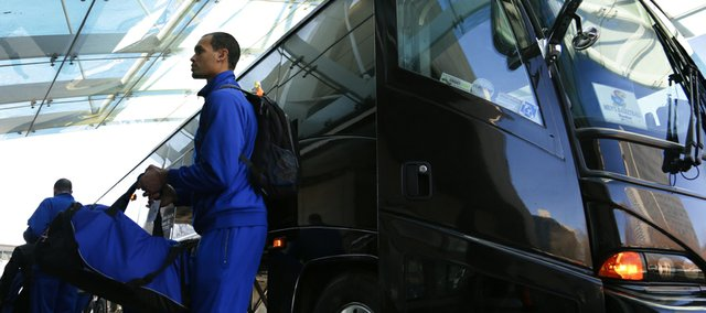 Kansas forward Perry Ellis exits the team bus after it arrived at the Westin Crown Center on Wednesday, March 20, 2013 in Kansas City, Mo.