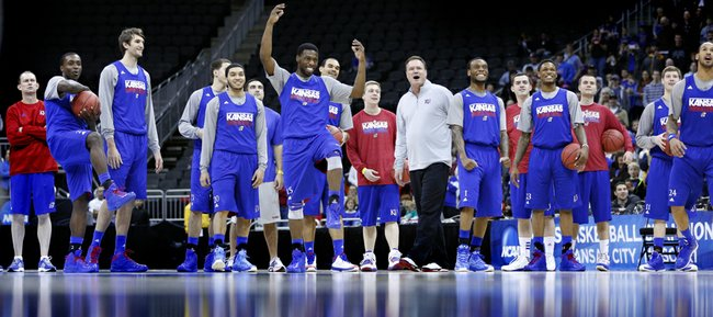 The Jayhawks react to a missed dunk by Justin Wesley as they entertain the fans at the end of their practice on Thursday, March 22, 2013 at the Sprint Center in Kansas City, Mo.