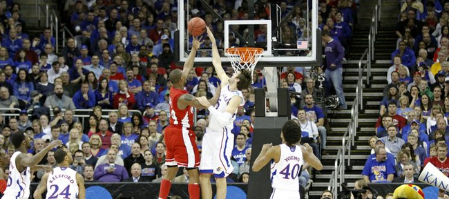 Jeff Withey (5) blocks George Fant in the Jayhawks second-round game against Western Kentucky Friday, March 22, 2013 at the Sprint Center in Kansas City, Mo.