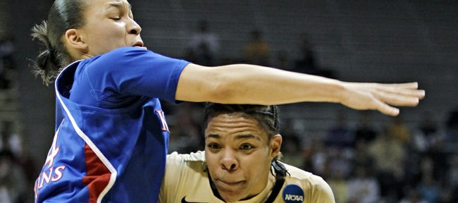 Kansas guard Markisha Hawkins, left, blocks the way to the basket against Colorado guard Chucky Jeffery in the first half of a first-round women's NCAA college basketball game on Saturday, March 23, 2013, in Boulder, Colo. KU won the game, 67-52.