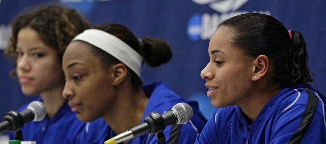 Kansas' Angel Goodrich, right, takes questions alongside Monica Engelman, left, and Carolyn Davis during a news conference one day before a second-round game against South Carolina in the NCAA women's college basketball tournament, Sunday, March 24, 2013, in Boulder, Colo.