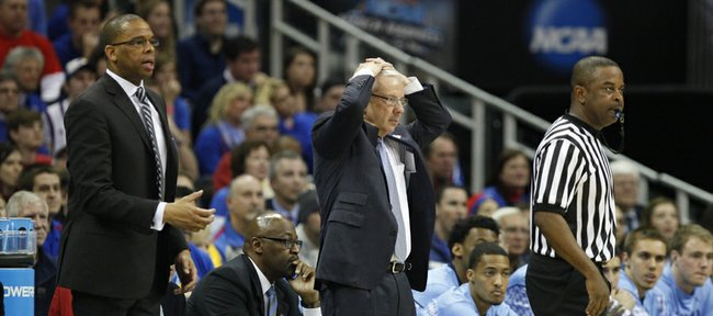 North Carolina head coach Roy Williams, center, puts his hands on his head during after a missed bucket by the Tar Heels in the second half, Sunday, March 24, 2013 at the Sprint Center in Kansas City, Mo.