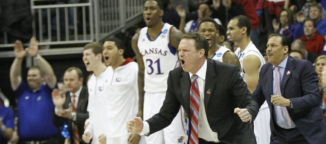 Kansas coach Bill Self cheers from the sidelines in the second-half of the Jayhawks 70-58 win against North Carolina Sunday, March 24, 2013 at the Sprint Center in Kansas City, Mo..