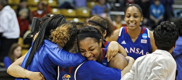 Kansas players celebrate after defeating South Carolina 75-69 in a second-round game in the women's NCAA college basketball tournament, Monday, March 25, 2013, in Boulder, Colo.