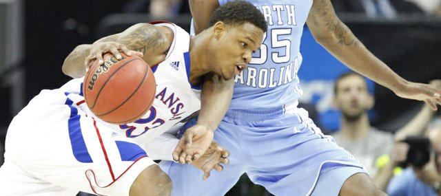 Kansas guard Ben McLemore drives against North Carolina guard Reggie Bullock during the first half, Sunday, March 24, 2013 at the Sprint Center in Kansas City, Mo.