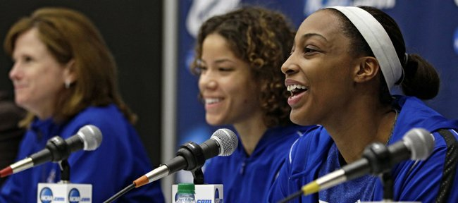 Kansas' Carolyn Davis, right, answers questions during a news conference Sunday, March 24, 2013 ahead of their second-round women's NCAA college basketball game against South Carolina in Boulder, Colo. Head coach Bonnie Henrickson, left, and Monica Engelman listen.