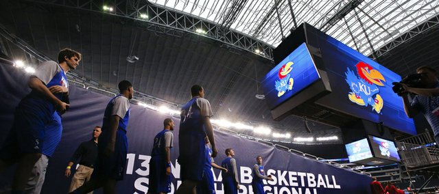 The Kansas Jayhawks look around at the vastness of Cowboys Stadium as they take the court for practice on Thursday, March 28, 2013.