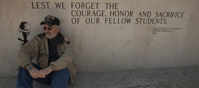 John Musgrave, of Baldwin City and seen here at KU's Vietnam War memorial, is a Vietnam veteran who is featured in documentary filmmaker Ken Burns' series about the war.