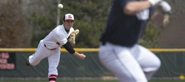 Lawrence High's Adam Rea delivers a pitch during the Lions' game against Blue Valley North on Saturday, March 30, 2013, at LHS.