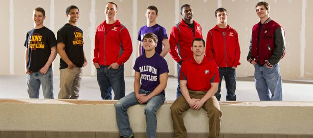 The Journal-World All-Area Wrestling Team, standing from left: Caden Lynch, Lawrence; Alan Clothier, Lawrence; Thomas Miller, Tonganoxie; Jon Pratt, Baldwin; Julius Coats, Tonganoxie; Clayton Himpel, Tonganoxie; and Andrew Denning, Lawrence. Seated, from left: wrestler of the year Bryce Shoemaker, Baldwin, and coach of the year Jeremy Goebel, Tonganoxie. Not pictured: Jake Ellis and Landon Scott, Mill Valley.