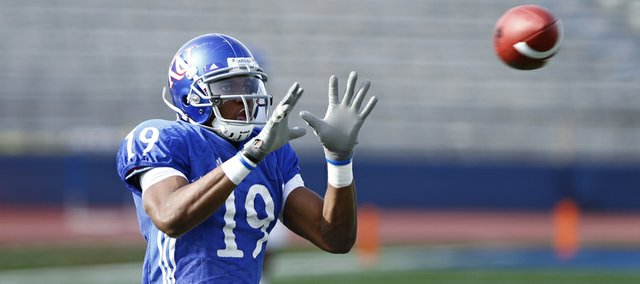 Kansas receiver Justin McCay makes a catch during a spring practice on Tuesday, April 2, 2013 at Memorial Stadium.
