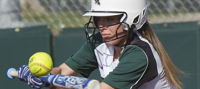 Free State sophomore Emily Bermel bunts in the Firebirds' doubleheader with Leavenworth on Thursday, April 4, 2013, at FSHS.