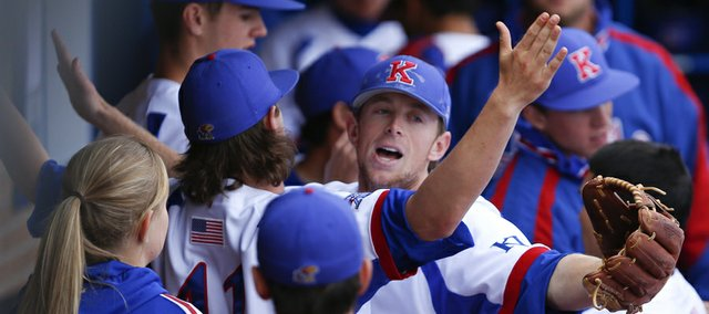 Kansas shortstop Kevin Kuntz, front, facing, bumps chests with Junior Mustain after turning a double play to get the Jayhawks out of the second inning with bases loaded on Friday, April 5, 2013 at Hoglund Ballpark.