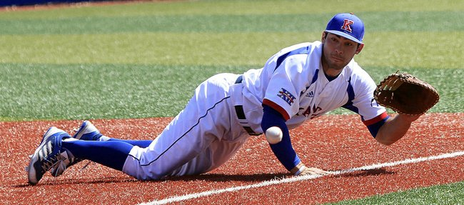 Kansas first baseman Ka'iana Eldredge gets down and dirty for a grounder in the Jayhawks' 13-4 loss to Oklahoma State on Saturday, April 6, 2013, at Hoglund Ballpark.