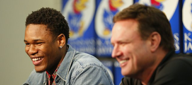 Kansas guard Ben McLemore smiles next to head coach Bill Self after saying that he will miss Self during a news conference in which McLemore declared his intention to enter the 2013 NBA Draft. Nick Krug/Journal-World Photo
